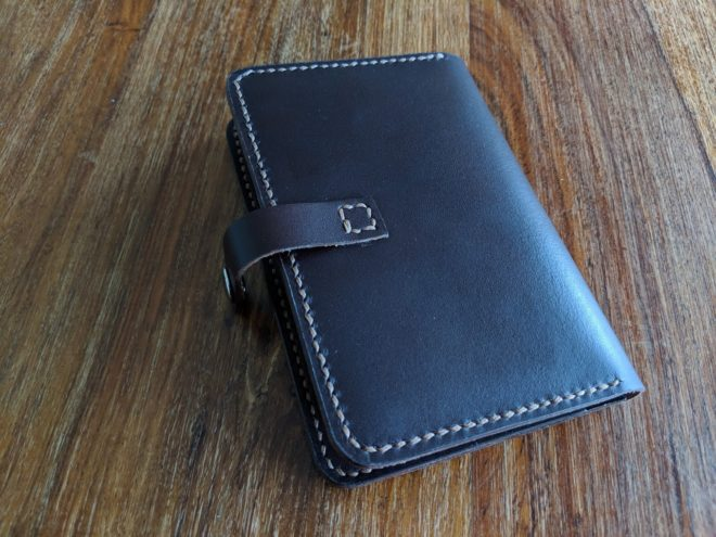 Leather passport holder. Hand cut, hand stitched, hand finished, handmade in Dorset.