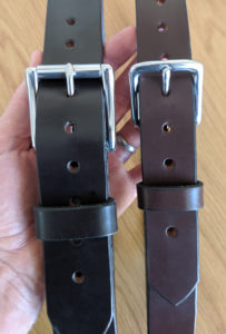 Leather belts of two different widths. Casual belt on the left and formal belt on the right.